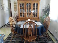 For sale is an oak dining room set, excellent