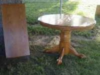 Oak Dining Room Table with extra leaf, in good