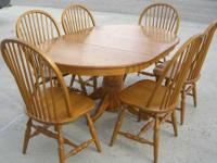 Extending Oak Dining Table and Chairs This is a