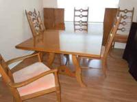 Solid oak dining table with three (12-inch) leaves.