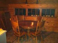 oak dining table in good condition. table comes with 4