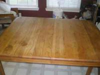 solid oak dining table. measures 53' X 41' asking $30.