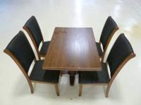 Never used dark oak dining table with 4 solid