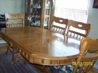 Description Oak dining table and 6 chairs. Table is 42""