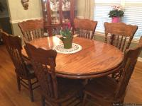 "Beautiful pedestal oval table measures 66"" with 18"""