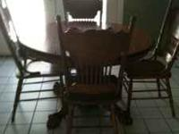 Round oak table with four chairs. Great condition.