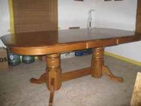 beautiful oak diningroom table,seats 6-10 people,has 2