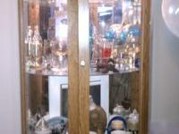 Got to move and I have to sell my Oak display Cabinet.