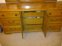 2nd owner. Oak dresser with 9 drawers and large mirror