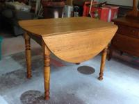 Heavy, oak, drop-leaf table Wooden hinged swing-out