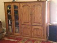 We have a beautiful medium oak entertainment center for