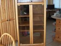 Oak Entertainment Cabinet has glass doors, 3 shelves,