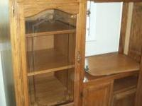 Solid Oak with glass doors and movie storage drawers.