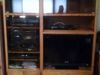 Nice oak entertainment center. Great condition. $125.00