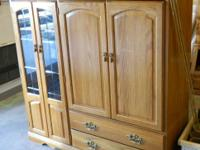 Very nice oak entertainment center. Dimensions are: