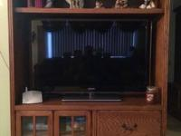 Nice oak entertainment center purchased at Nebraska