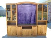 Solid Oak Entertainment Center. Comes in 5 pieces.