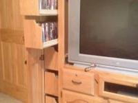 Large oak entertainment center with roll out shelves
