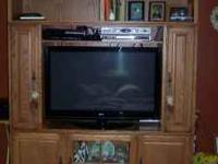 Large oak entertainment center, came from Robert Miller
