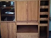 A very nice built oak entertainment center, in storage