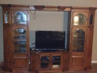 This is a real wood entertainment center, that has