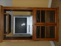 "Oak entertainment center 60"" tall 22"" deep and 38"""