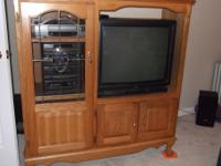 SELLING FOR A FRIEND. OAK ENTERTAINMENT CENTER