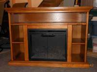 Just like new Oak entertainment center with electric