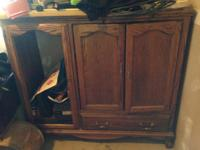 Oak entertainment center $100 obo, weight machine $50