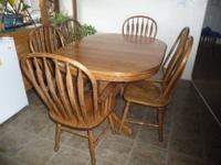 Oak finish dining table set. Butterfly leaf expands