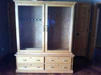 This is a solid oak gun cabinet. It has holders for 9