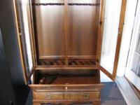 Lighted Oak gun case for sale. Holds 10 guns, has hand