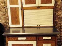 Antique oak Kitchen Maid hoosier cabinet. Excellent