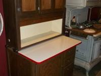 Nice clean oak Hoosier cabinet with roll top and tin