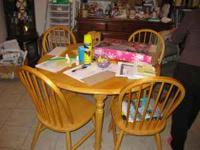 Nice table and chairs in great condition call Angie  no