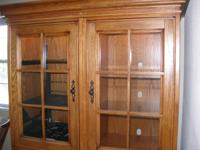 Big Oak home entertainment center cabinet, two pieces.