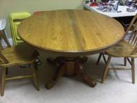 "48"" diameter round oak table. Comes with 2 chairs. $75"