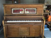 Oak Player Piano upright with covered key board.