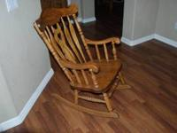 Heavy oak rocking chair for sale. Good condition $50.00
