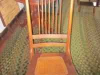 Classic spindle back caned seat rocker. Good patina.