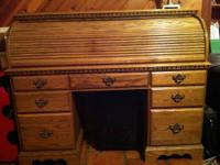 7 drawer oak writing desk with many pigeon holes for