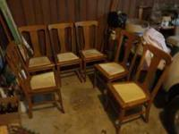 A set of 6 light oak dining room chairs. Bottoms have