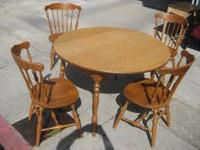 Nice oak table with 4-chairs in great shape... like