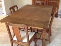 Solid oak table, 2 drop leaves, 1 on each end. Includes