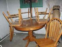 Newer oak pedestal table and four chairs. Excellent