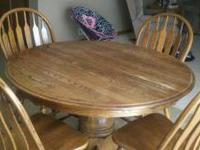 We are selling our oak table with four chairs because