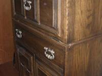 These two cabinets are oak and in excellent condition.