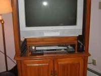 Beautiful solid oak entertainment hutch .with RCA tv