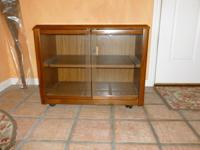 Beautiful oak TV stand.  Exterior finish in excellent