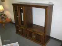 We have a great oak TV stand for sale. It has 2 glass